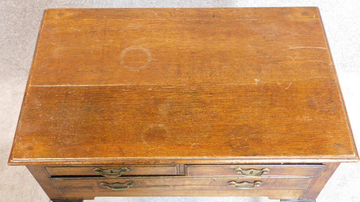 Lot 6 - A Georgian country oak lowboy, fitted drawers on cabriole supports. 70x72x45cm