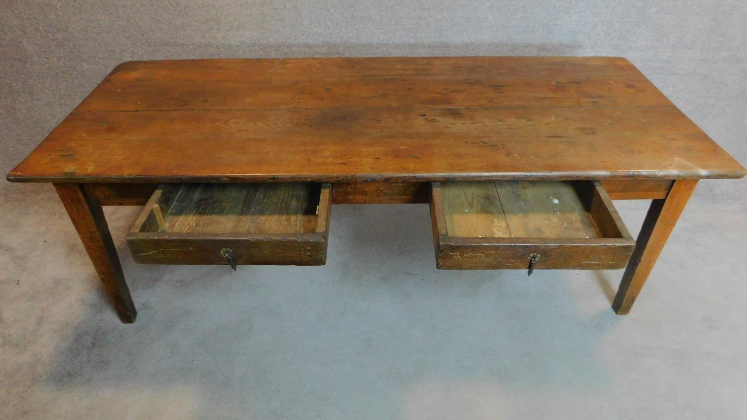 Lot 14 - An antique elm farmhouse style refectory table fitted two frieze drawers on square section