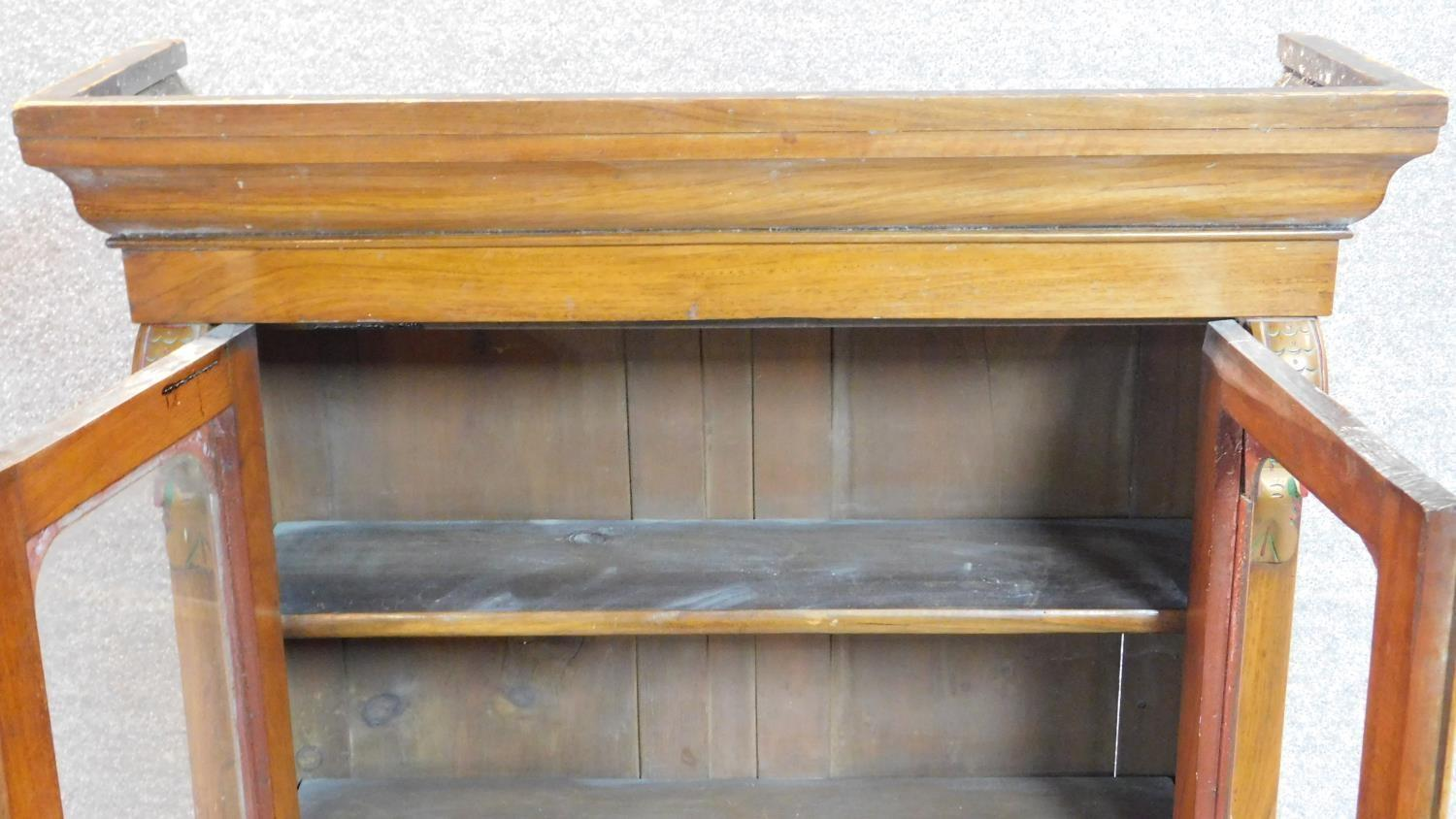 Lot 23 - A late Victorian mahogany bookcase section with twin glazed doors. 122x98cm (One pane detached but