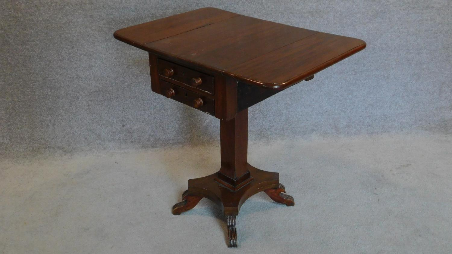 Lot 12 - A 19th century mahogany drop flap work table fitted frieze drawers. 69x71x49cm