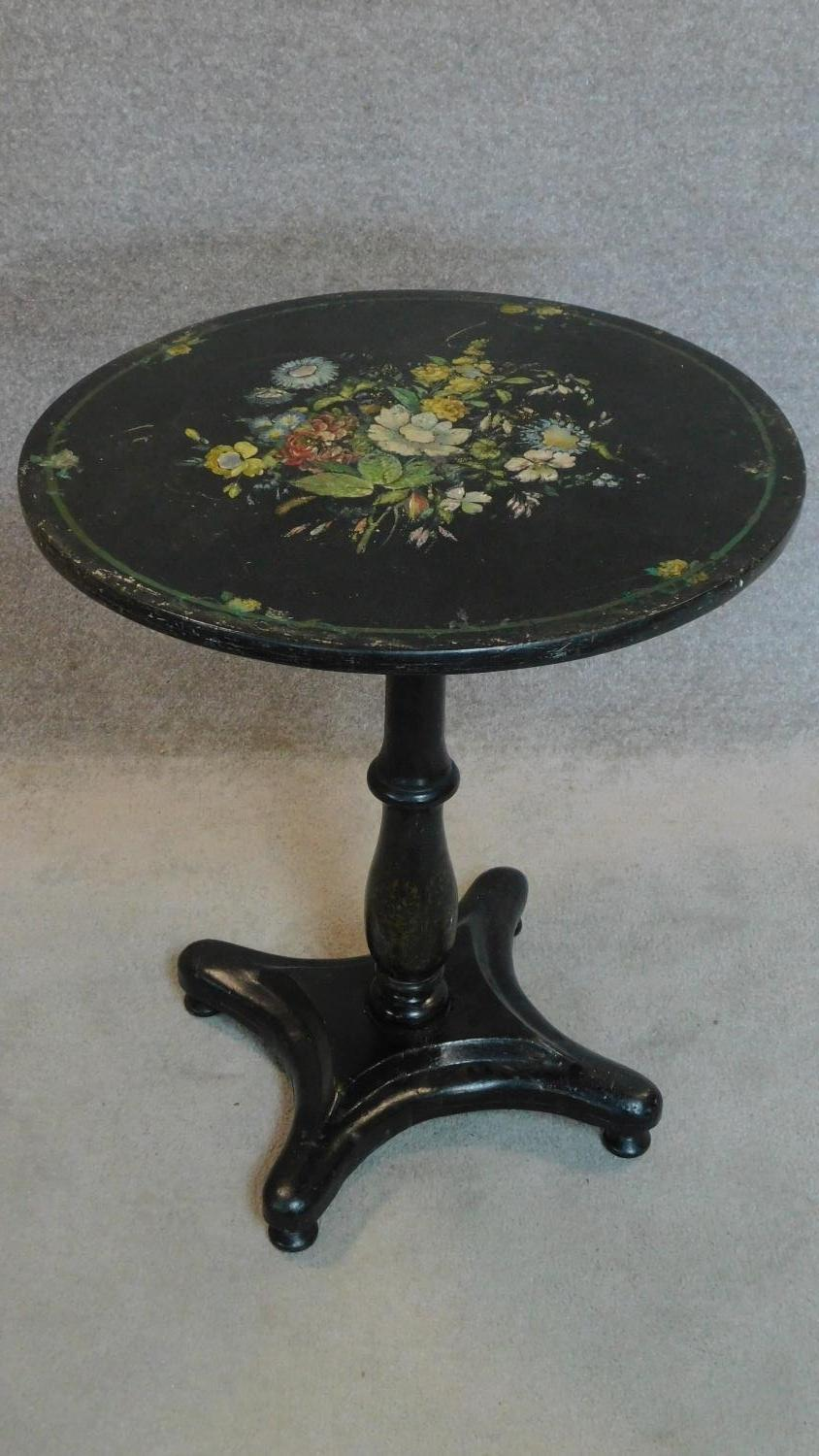 Lot 13 - A Victorian ebonised painted and mother of pearl inlaid circular occasional table. 70x61x61cm