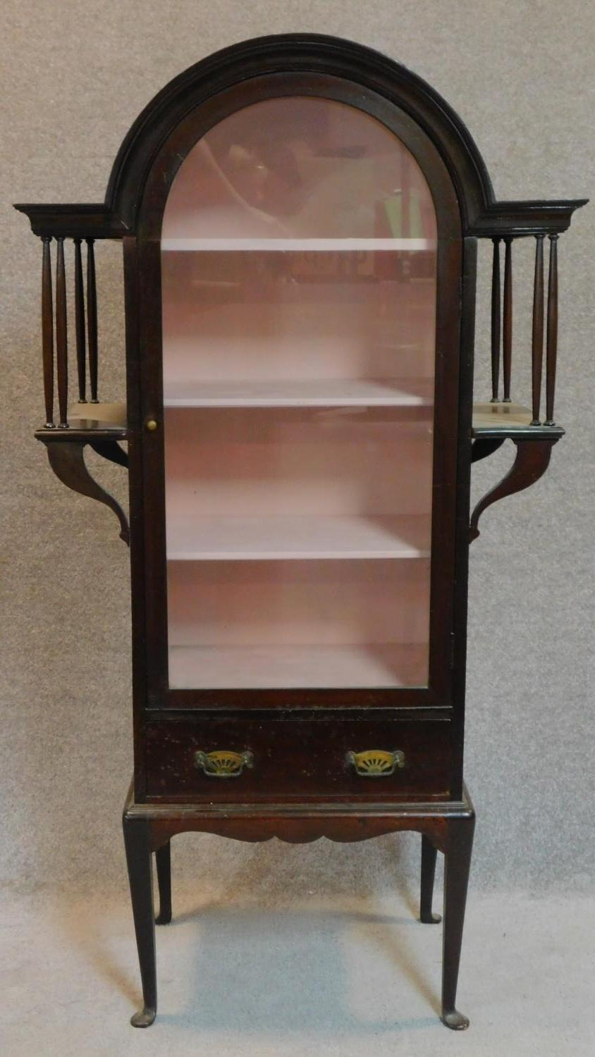Lot 28 - A late 19th century mahogany domed top Art Nouveau style display cabinet on cabriole supports.