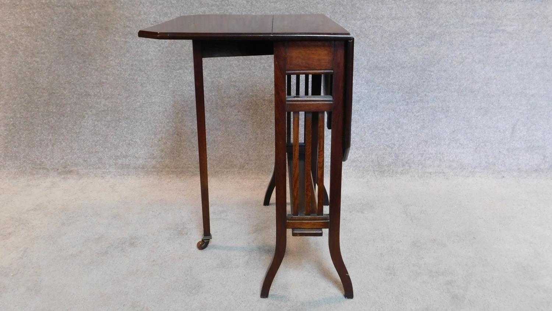 Lot 8 - An Edwardian mahogany drop flap Sutherland table late 65x73x60cm