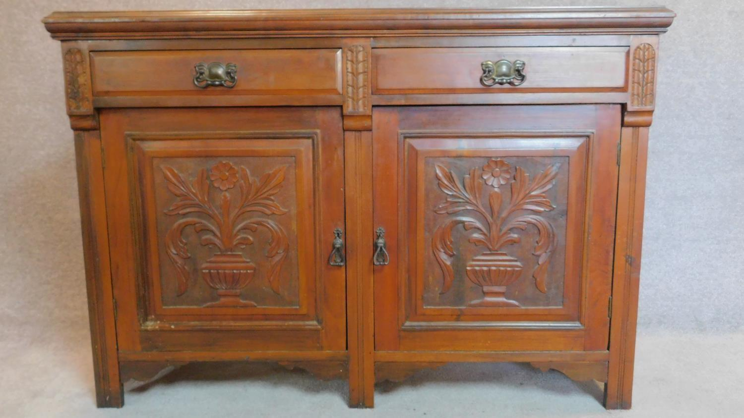 Lot 18 - A late 19th century carved walnut mirror backed sideboard. 195x135x47cm