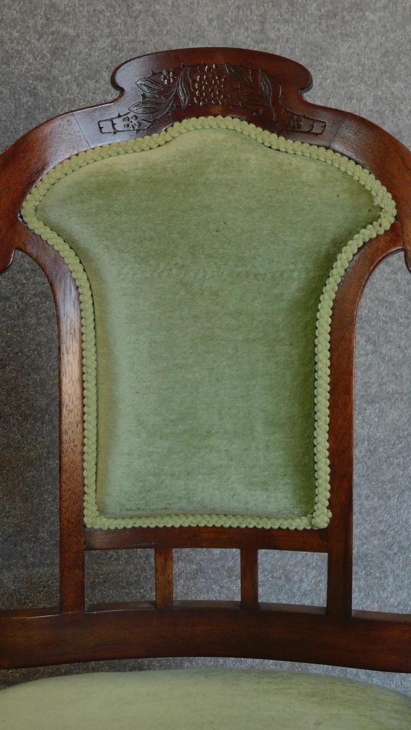 Lot 11 - A pair of walnut framed Art Nouveau carved back armchairs. H.106cm