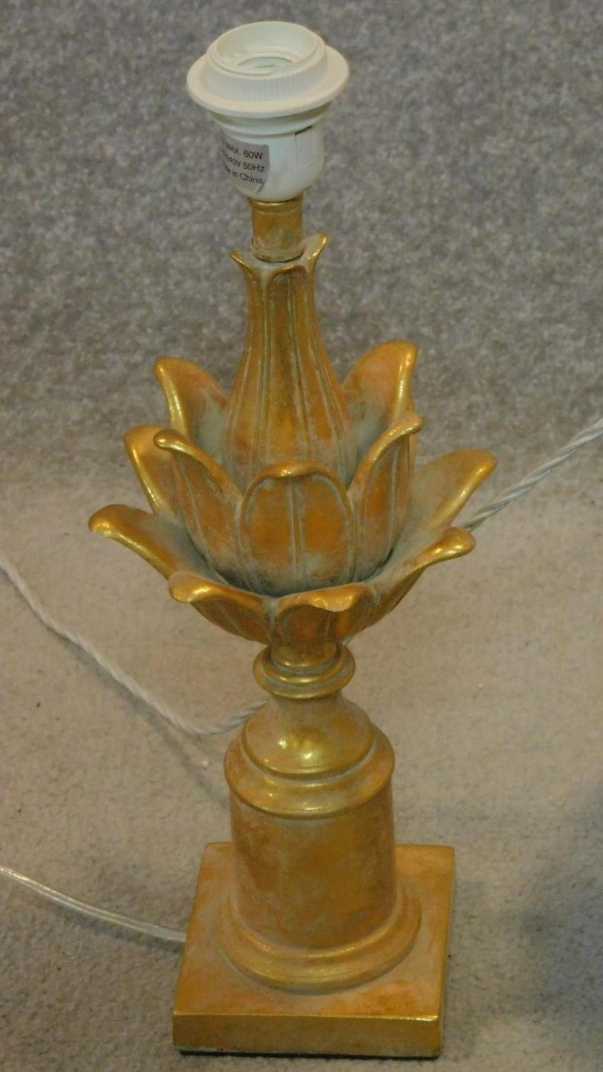 Lot 173 - A bulbous glass table lamp, a carved gilt acanthus shaped table lamp and a single rosebud