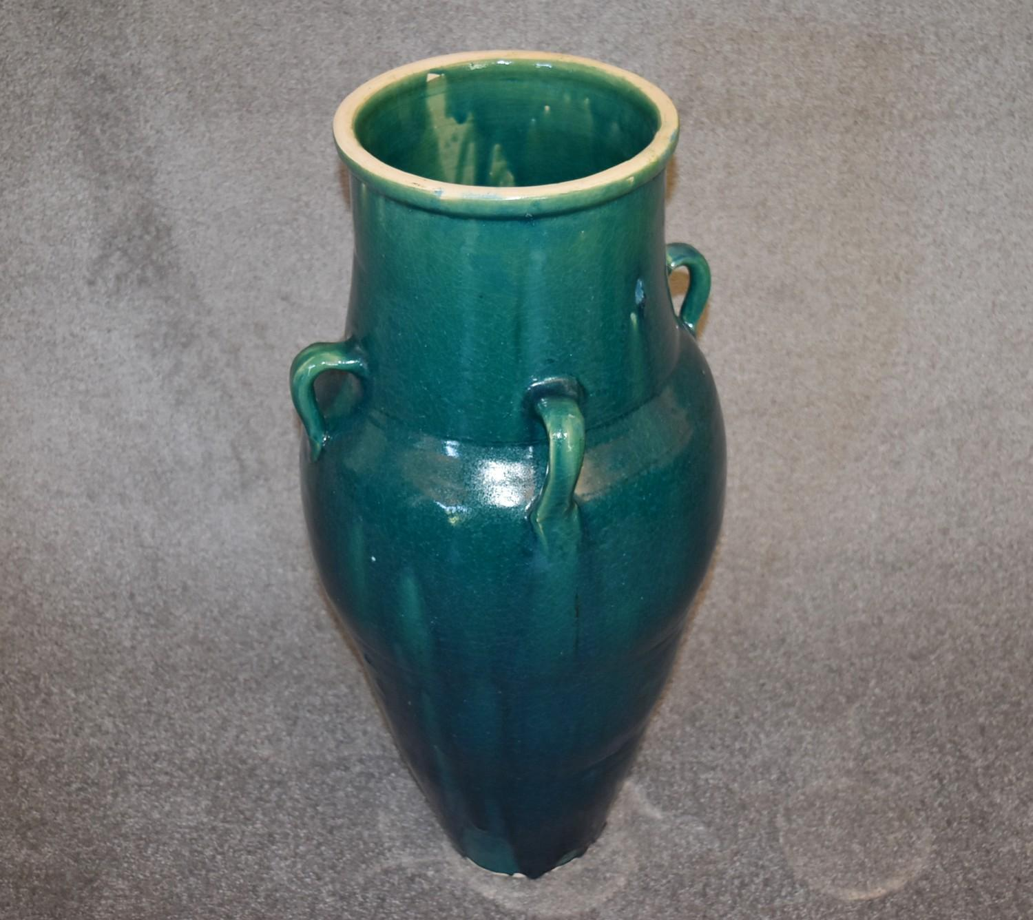 Lot 22 - A large green drip glazed sharab wine vessel with four handles. H.87cm