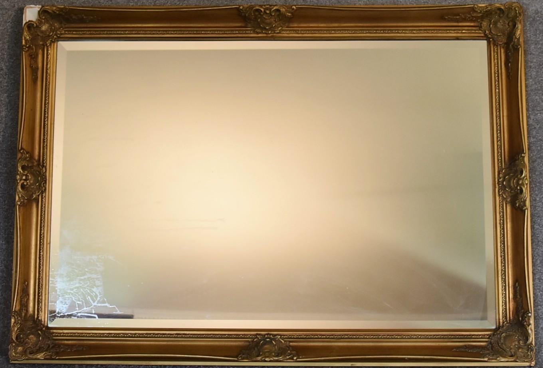 Lot 10 - A gilt framed wall mirror with rectangular bevelled plate. 73cm x 100cm