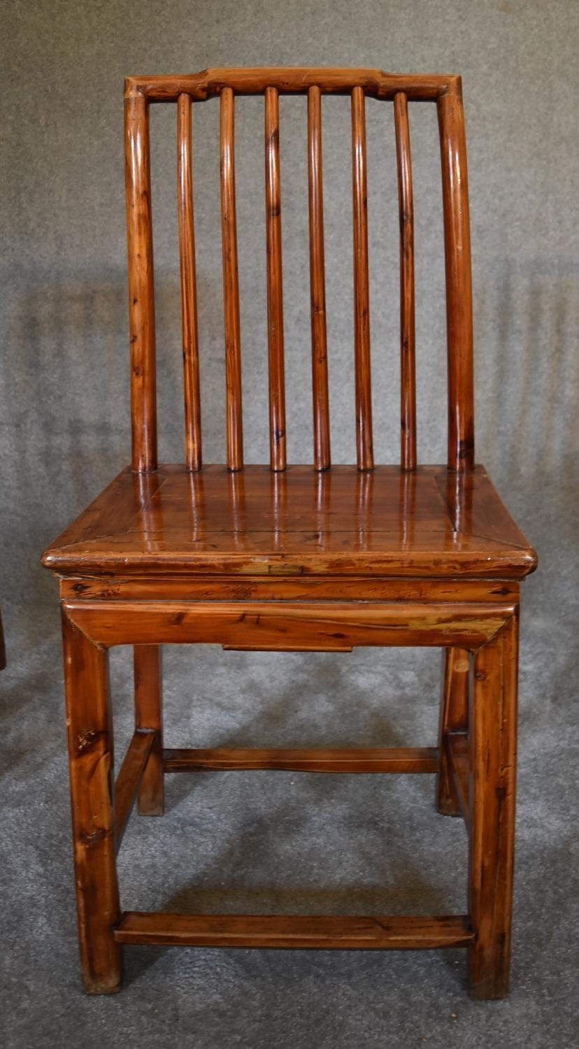 Lot 19 - A set of four Chinese hardwood dining chairs on square section stretchered supports. H.100 x 36cm