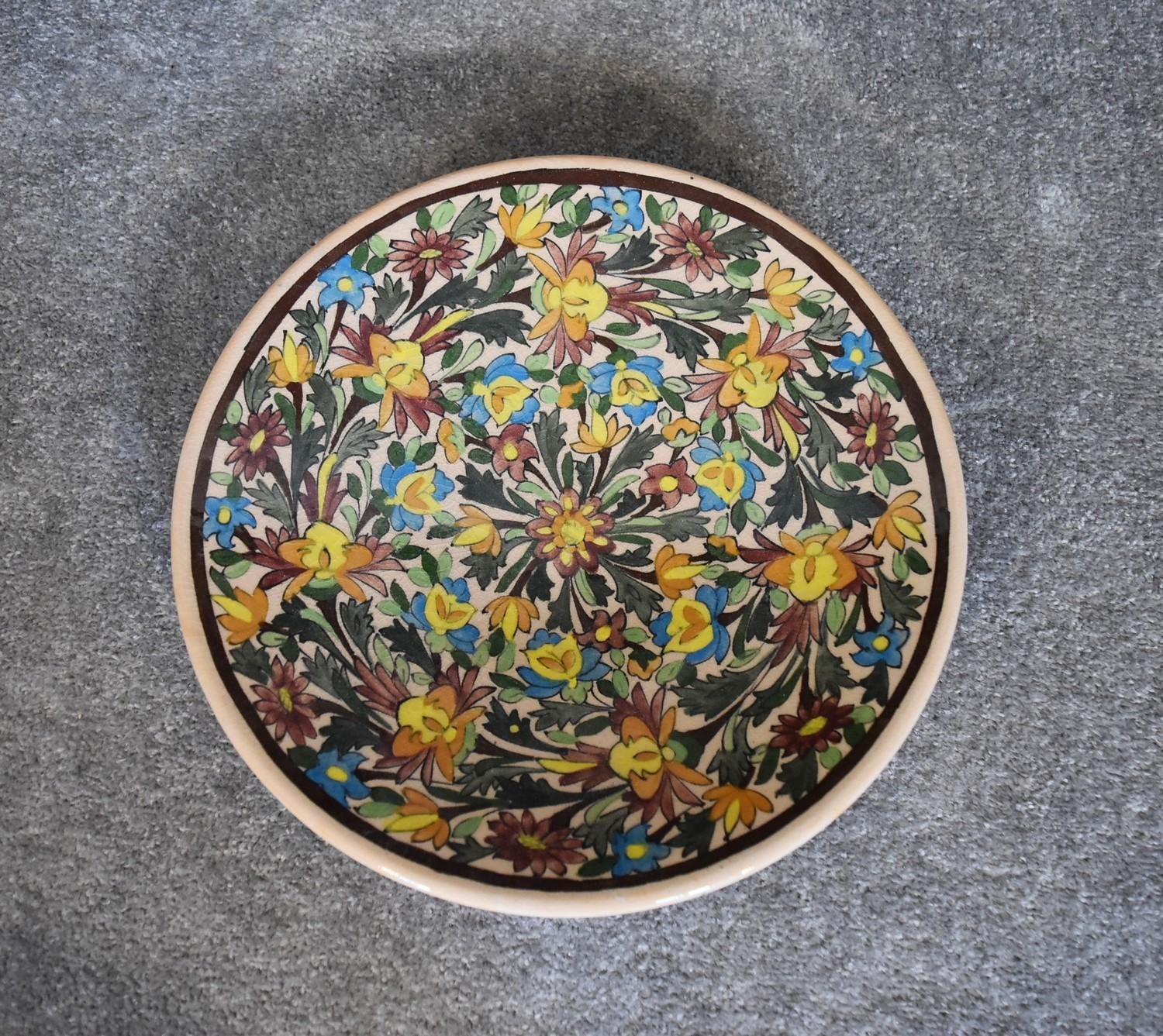 Lot 24 - A large ceramic Persian shallow bowl with allover floral pattern. Dia.36cm