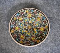 A large ceramic Persian shallow bowl with allover floral pattern. Dia.36cm