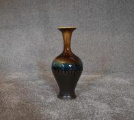 A tall Persian drip glazed vase. H.30cm