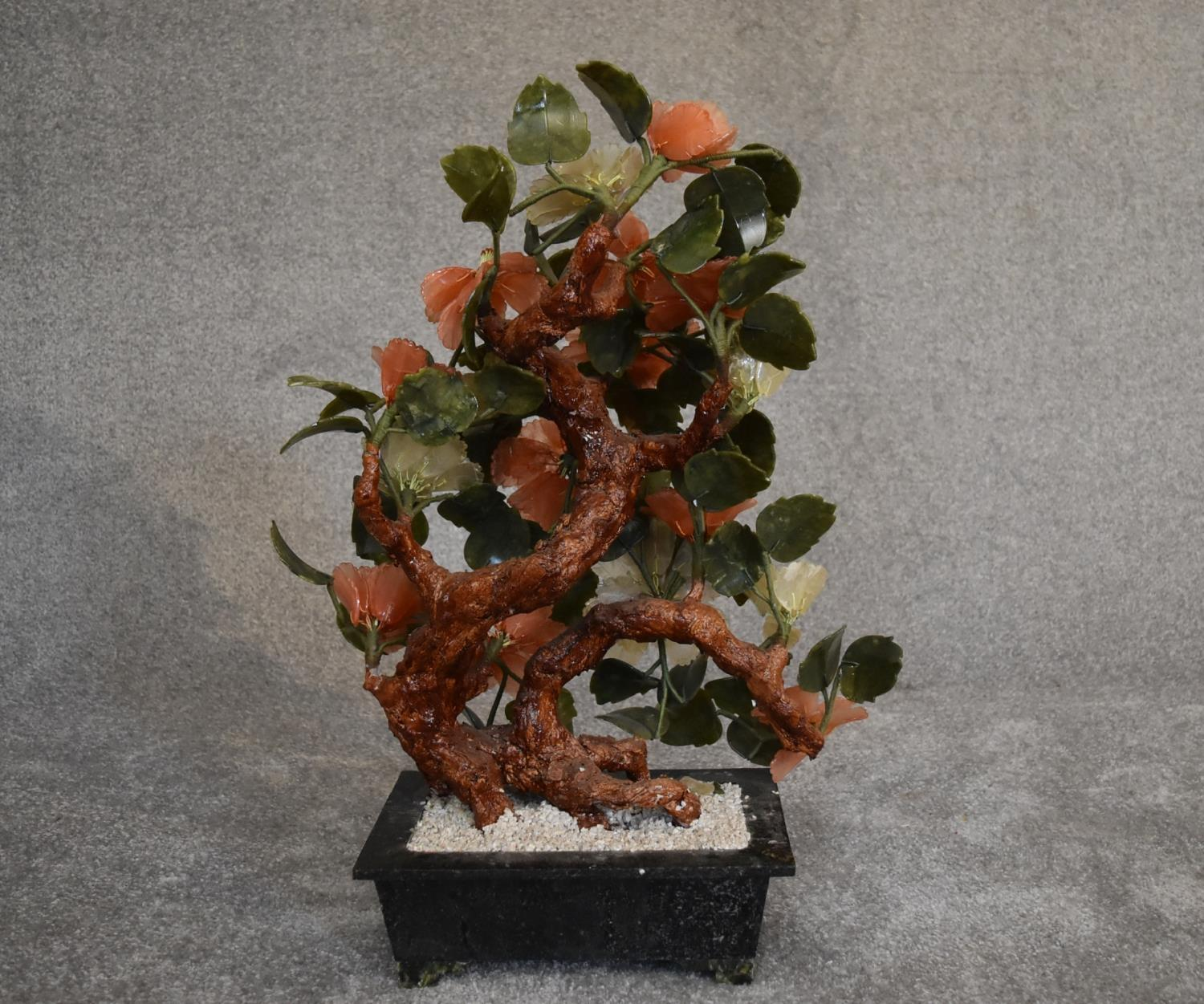 Lot 18 - A Chinese carved jade and agate ornamental blossom tree with carved petals and leaves, in