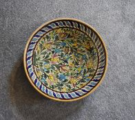 A large Persian ceramic shallow bowl with allover floral pattern. Dia.42cm