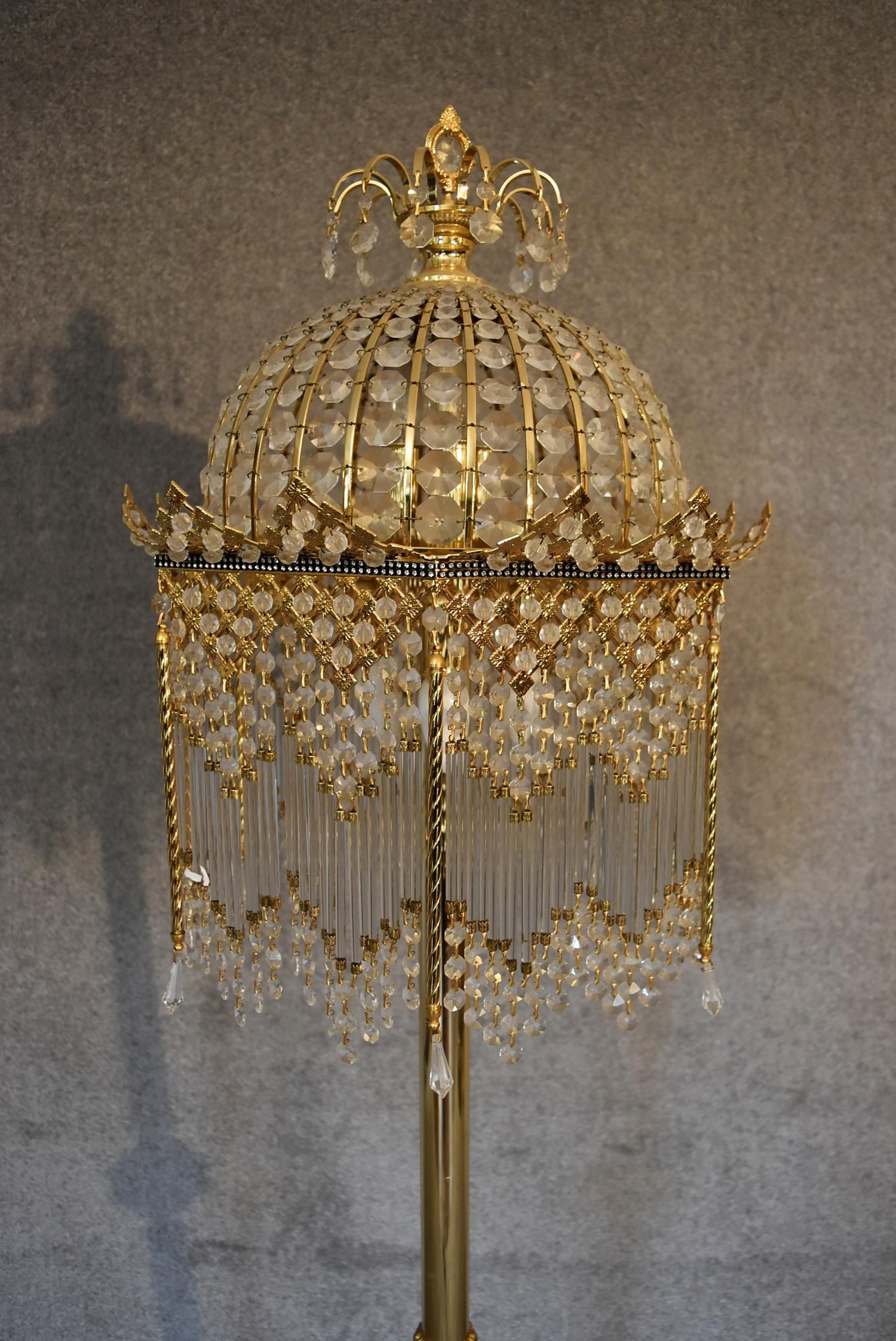 Lot 12 - A gilt metal and crystal standard lamp. 1.7m tall