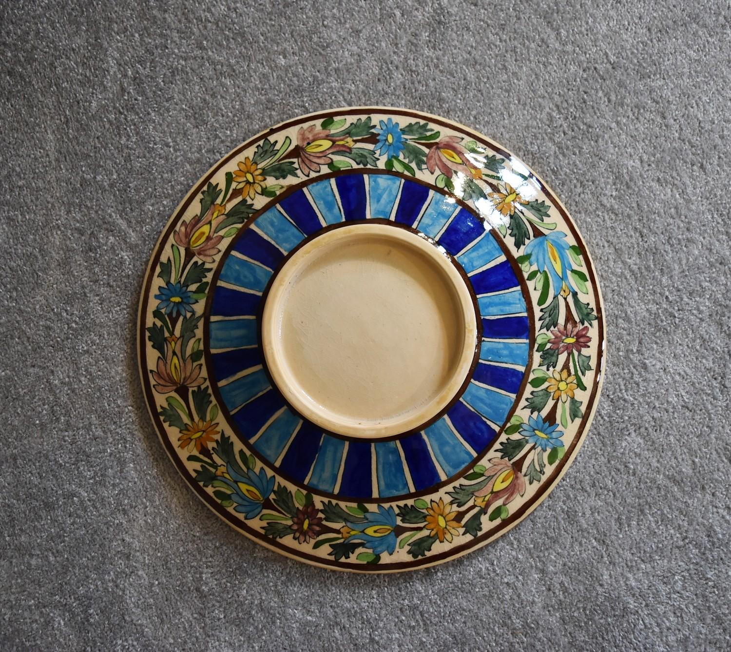 Lot 26 - A large Persian ceramic shallow bowl with allover floral pattern. Dia.42cm