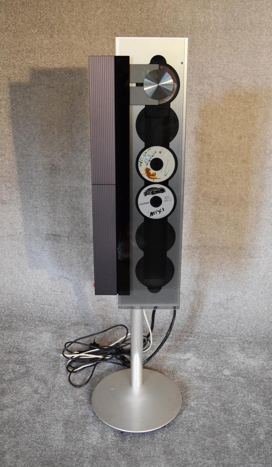 Lot 3 - A Bang and Olufsen BeoSound 9000 vertical 6-CD player with floor stand. H 133 x 36cm