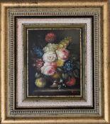 A gilt framed oil on, still life flowers. 39cm x 43cm.