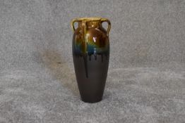 A Persian drip glazed vase with four handles. H.30cm