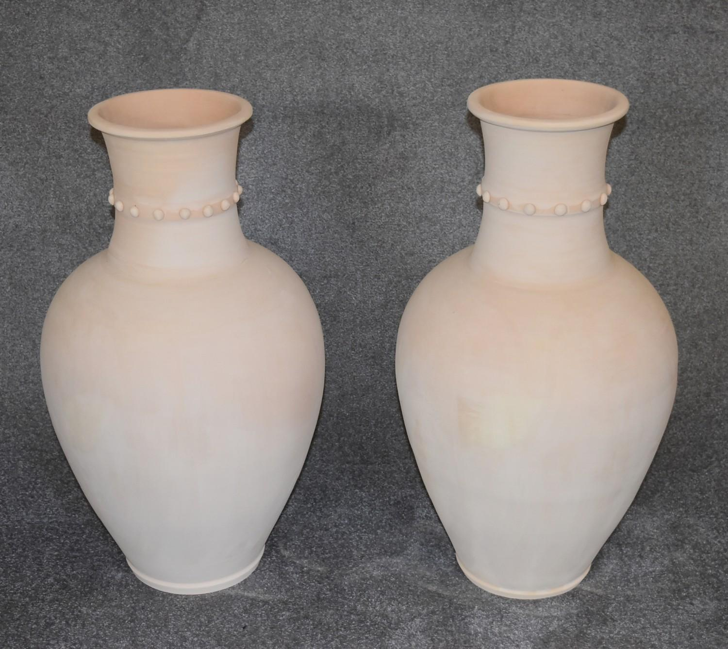 Lot 23 - A large pair of Persian Hamadan storage pots with studded collars. H.83 W.50cm