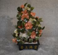 A Chinese carved jade and agate ornamental blossom tree with carved petals and leaves, in
