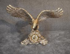 A large brass mantel clock in a naturalistically stylised case in the grasp of a flying eagle . 80cm