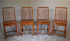 A set of four Chinese hardwood dining chairs on square section stretchered supports. H.100 x 36cm