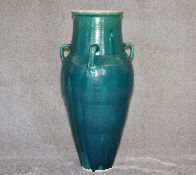 A large green drip glazed sharab wine vessel with four handles. H.87cm