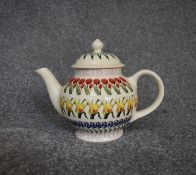 A 20th Century globular form teapot with floral design, by Emma Bridgwater. H22cm