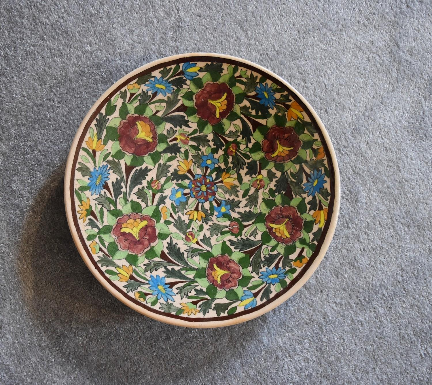 Lot 25 - A large ceramic Persian shallow bowl with allover floral pattern. Dia.40cm