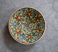 A large ceramic Persian shallow bowl with allover floral pattern. Dia.40cm