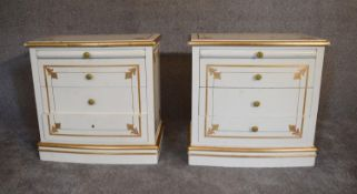 A pair of cream and gilt bedside cabinets fitted two drawers and slide each with plate glass top.