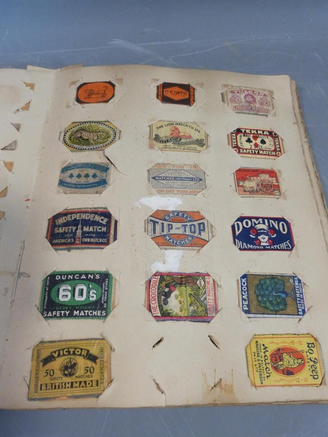 Lot 250 - A collection of matchbox lids and cigarette cards in hardback albums and paperback books.