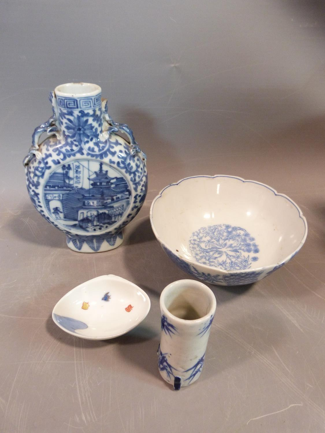 Lot 16 - A collection of Japanese and Chinese ceramics including two handled moon vase, Blue and white