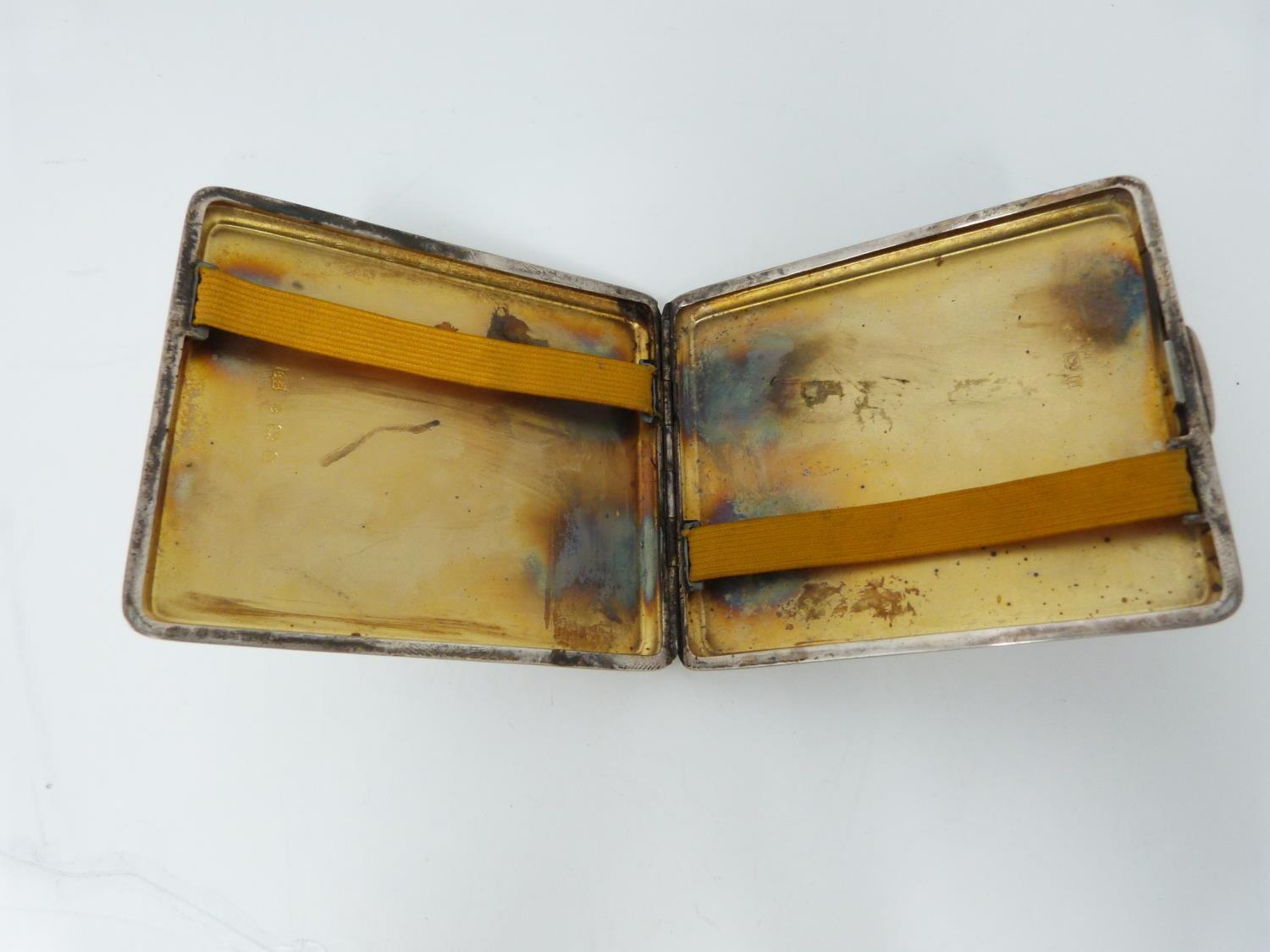Lot 7 - A silver cigarette case with engine turned decoration, London, 1948, gilded interior, Bravingtons