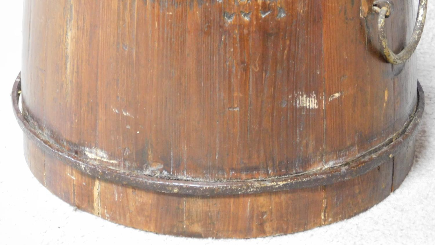 Lot 11 - A 19th century wooden Chinese grain bucket with carved Chinese characters to the side. Brass handles