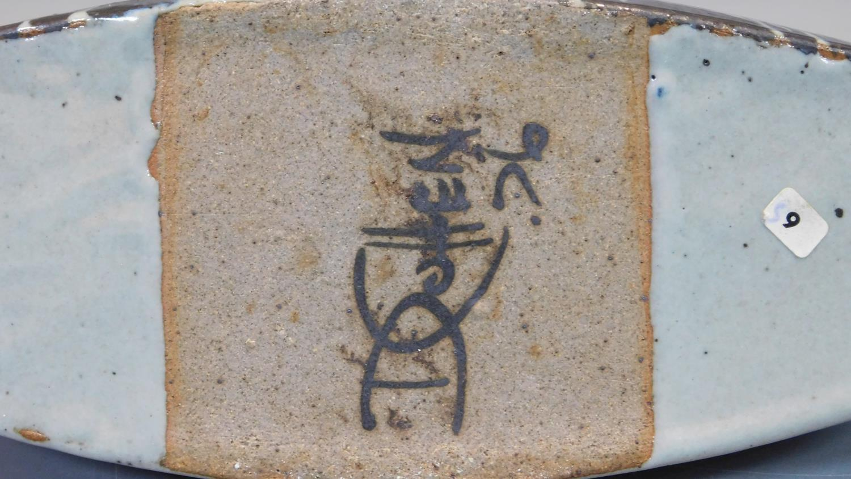 Lot 23 - An studio pottery Raku glazed vase with Oriental inspired design, signed D Cohen to base, 1976. H.