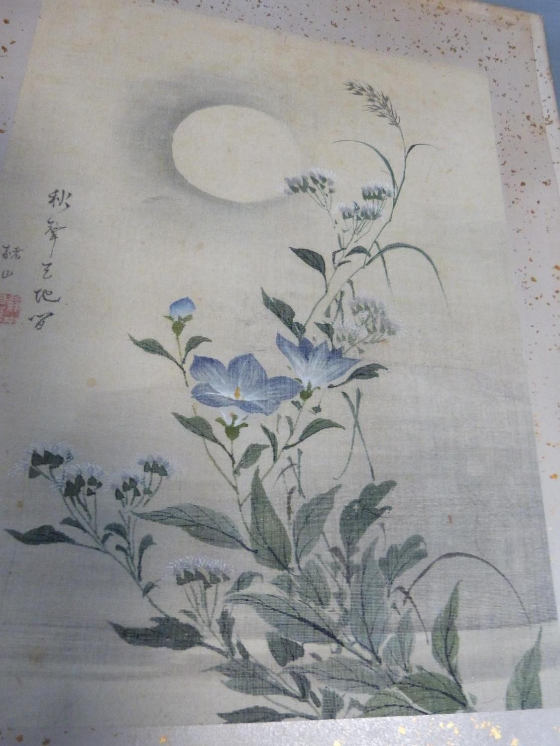 Lot 18 - A pair of oriental paintings on fabric of floral and plant studies with artist seal. Mounted in