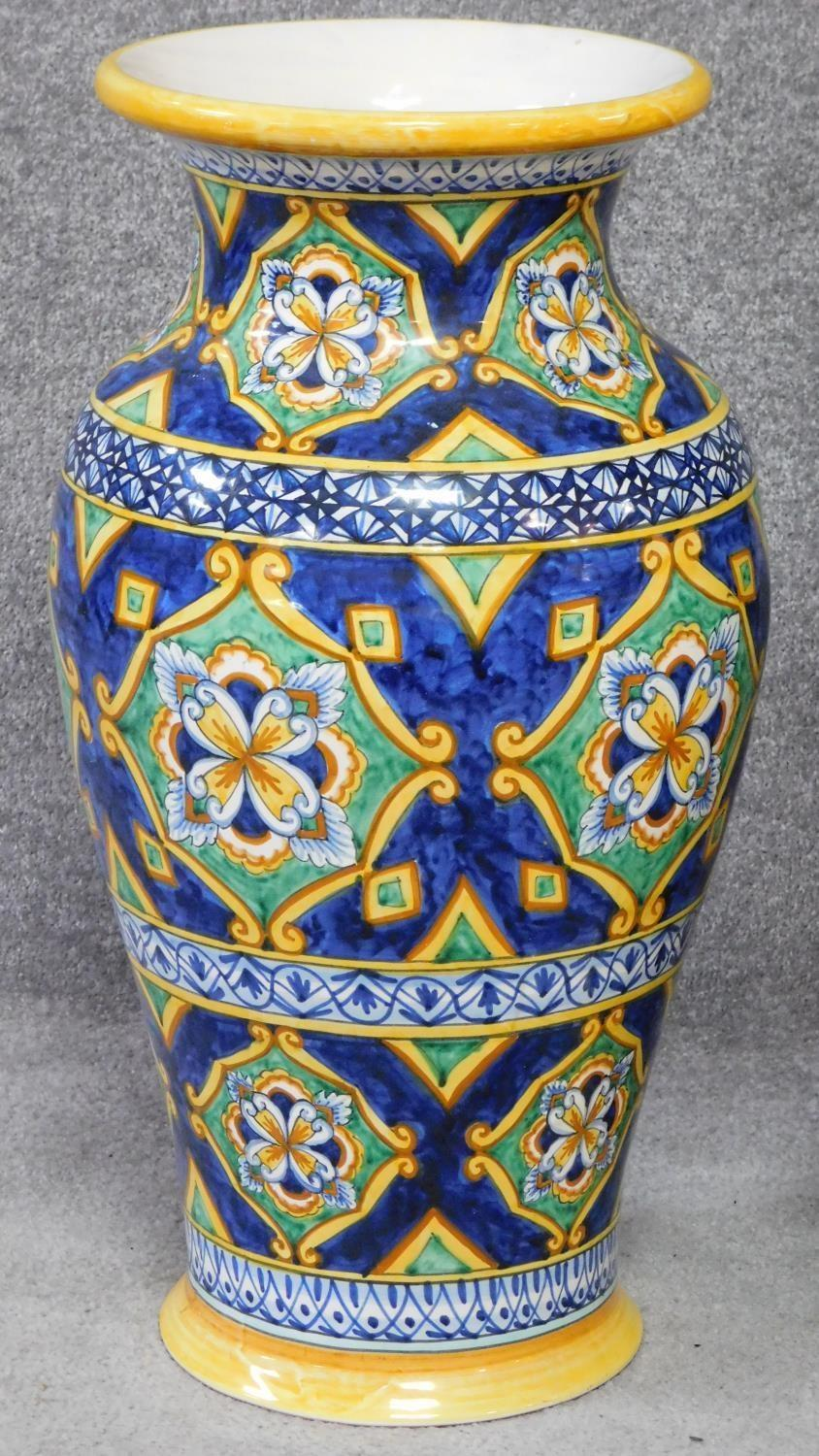 Lot 20 - Two large Italian majolica vases with colourful hand painted abstract design. Inscribed on the