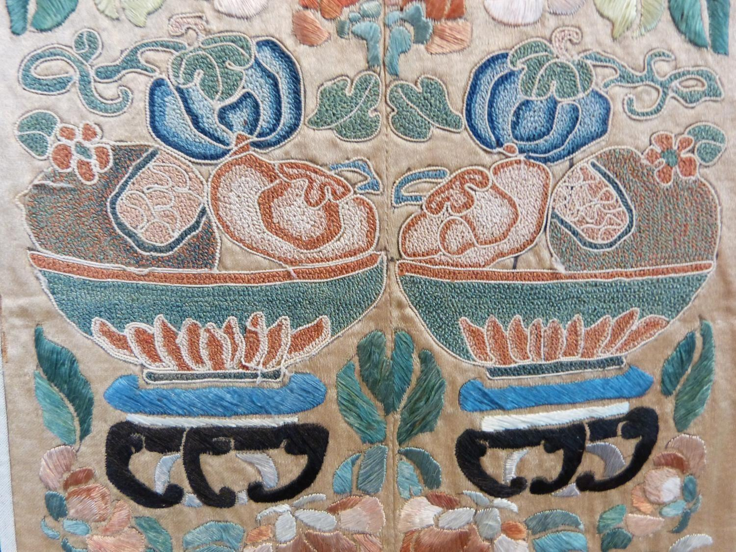 Lot 15 - A pair of antique Chinese embroideries. One with details of Chinese lucky bats and central white