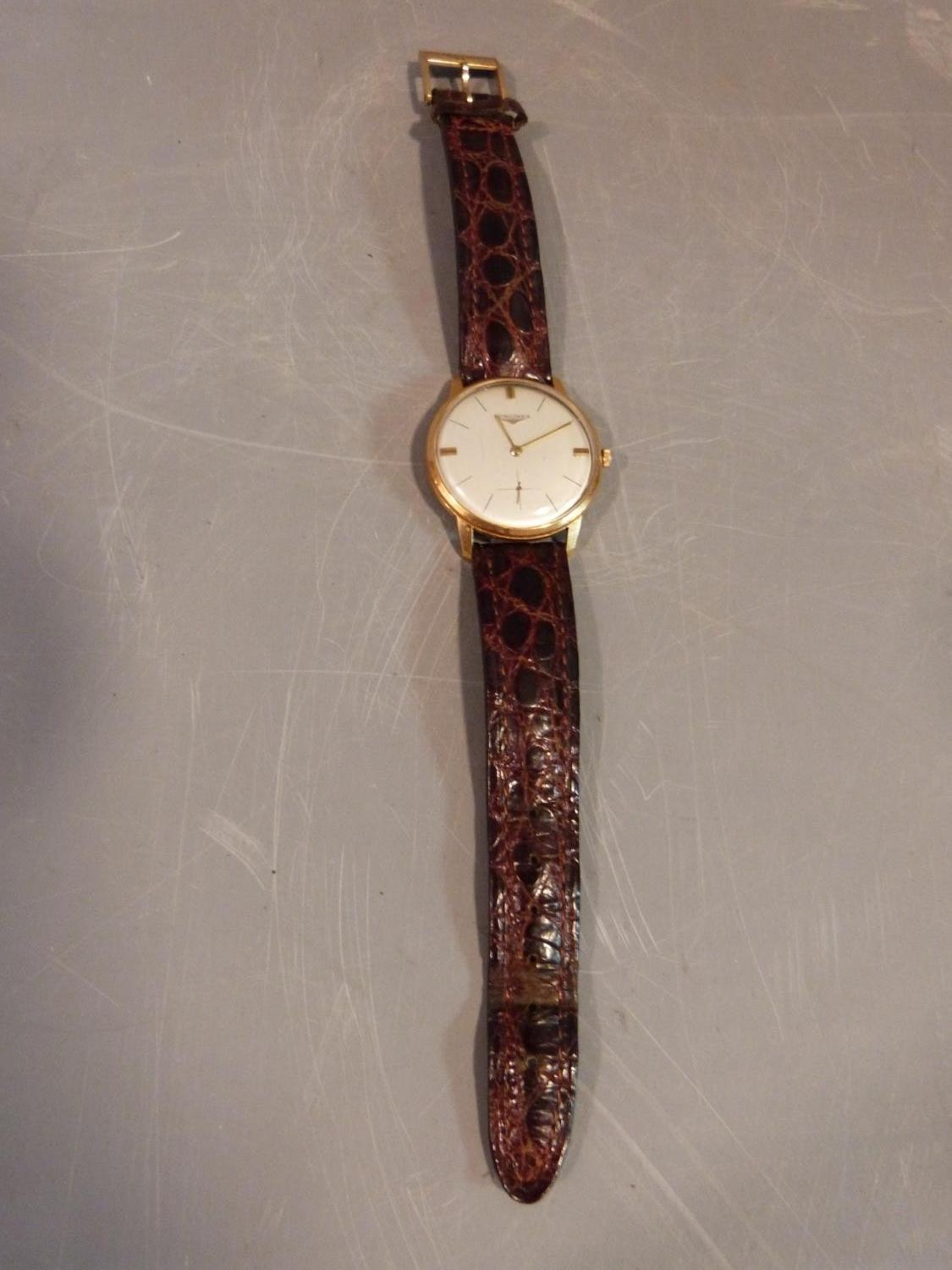 Lot 1 - A vintage Longines Mens Watch with brown alligator leather strap and Longines buckle. Not working.