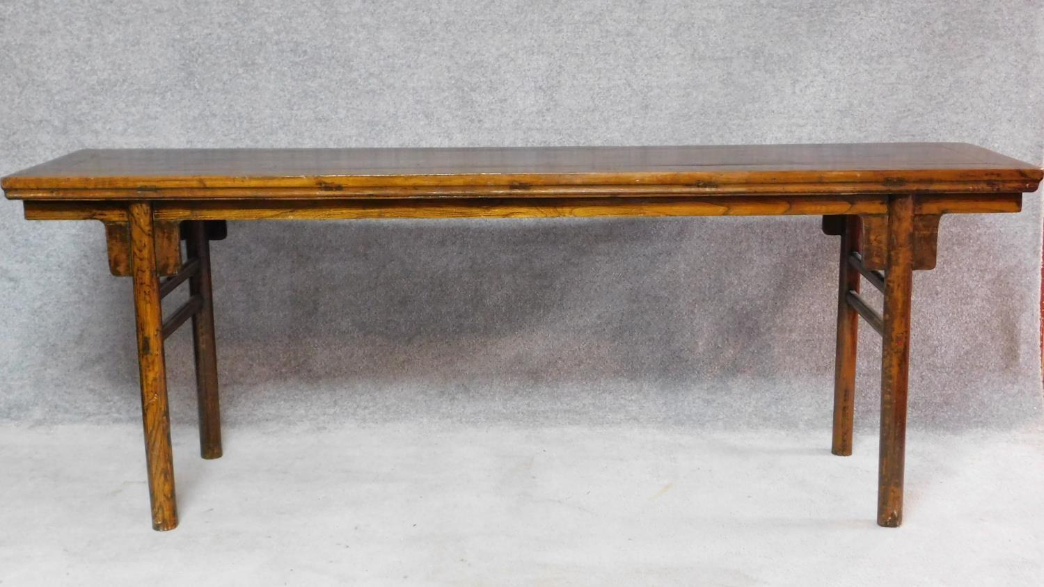 Lot 14 - A large Chinese hardwood alter table with rectangular top on circular section supports. H.81 W.223