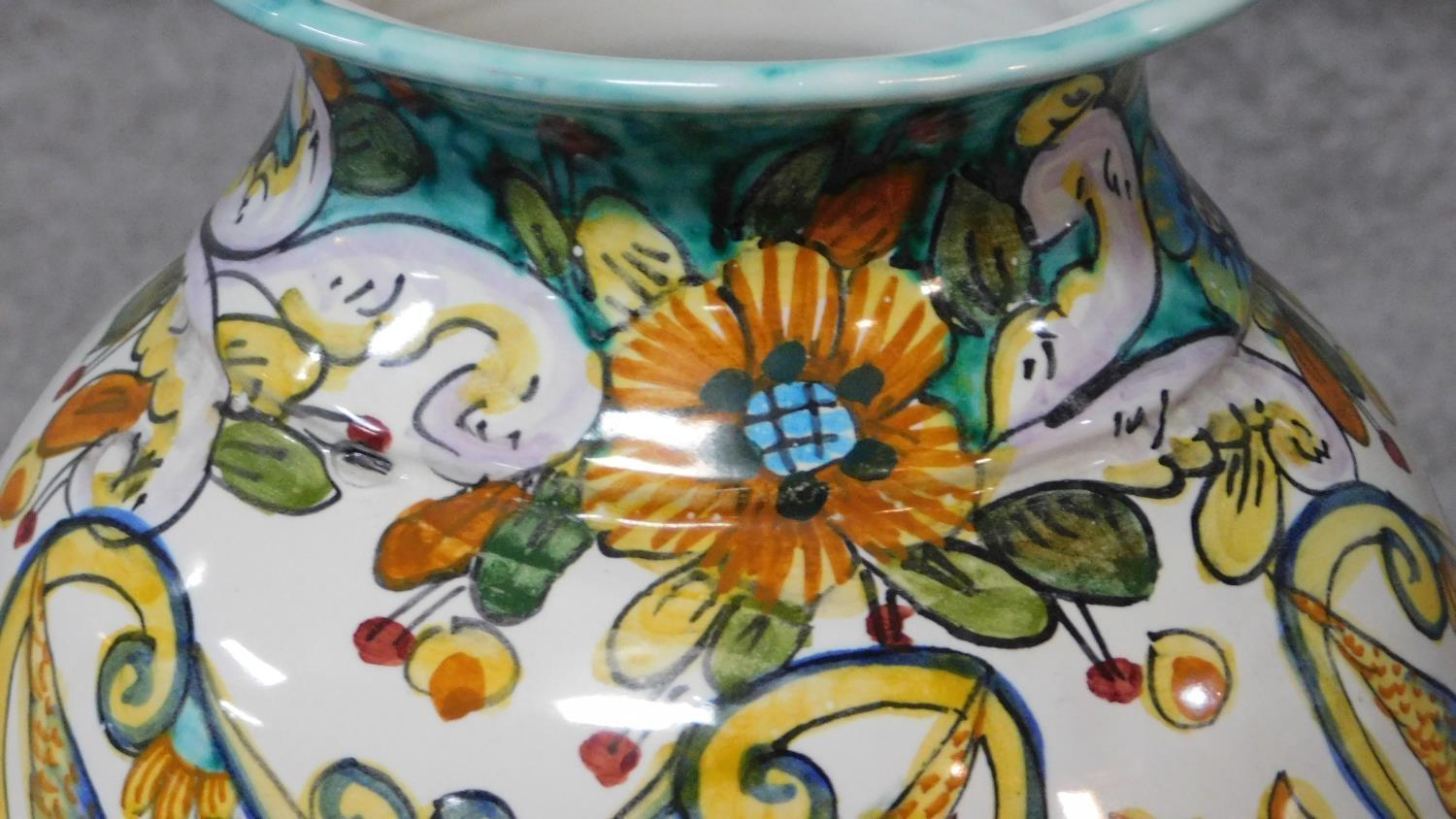 Lot 21 - Three Italian majolica vases with colourful handpainted abstract designs. Inscribed to base. H.