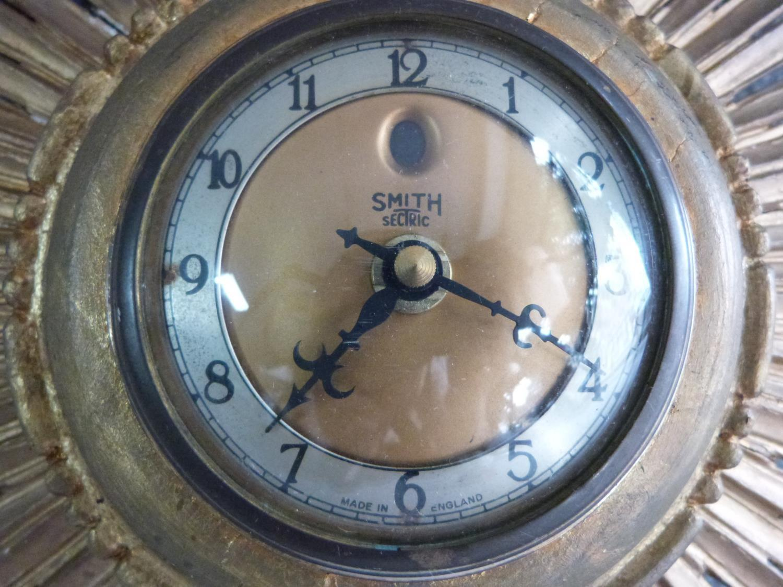 Lot 2 - A vintage sunburst giltwood clock by Smiths Sectric. Label on side. H 40cm.