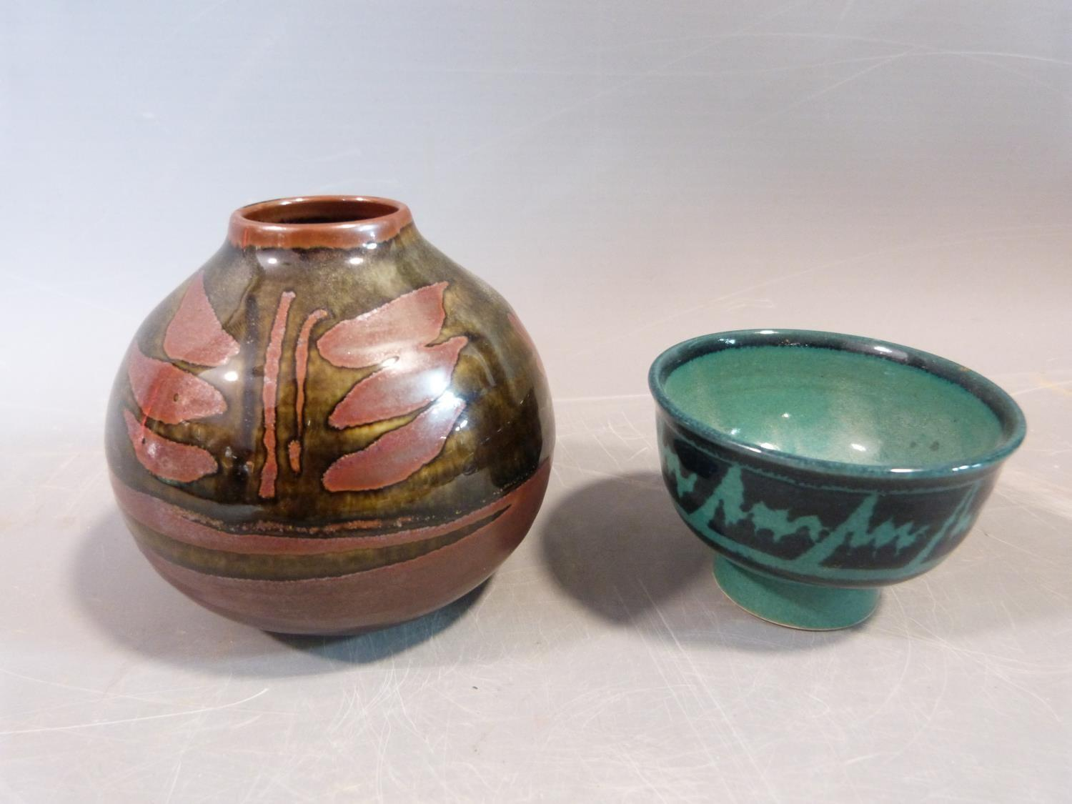Lot 26 - A pair of studio pottery pieces by David Lloyd Jones. The vase with an abstract stylised foliate