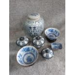 A collection of oriental ceramics. Including a ginger jar, two bowls on stands and three lidded pots