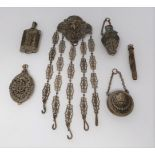 A cut steel french chatelaine with five attachments, mirror, dance card, snuff bottle, propelling