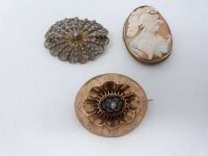 A collection of yellow metal and silver antique brooches. Including a yellow metal garnet and seed
