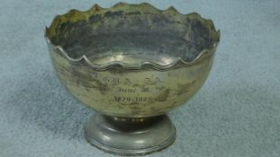 An antique silver pedestal bowl with waved edged, makers mark HE Ltd for Hawksworth, Eyre & Co