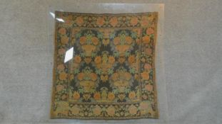 An antique Chinese silk embroidered wall hanging in a protective perspex display cover.